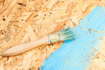 Paint brush on wooden board