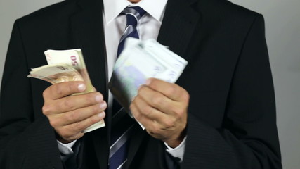 Unrecognisable businessman counting euro banknotes