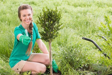 Young woman gardening for the community
