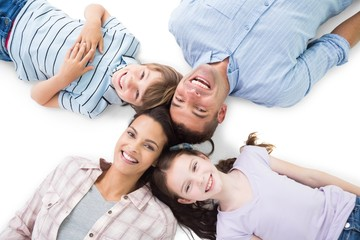 Happy parents and children lying on white background