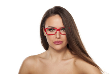 pretty young woman with glasses posing on a white background