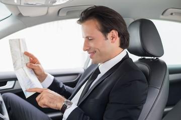 Businessman reading a map
