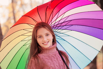 happy girl with umbrella outdoor