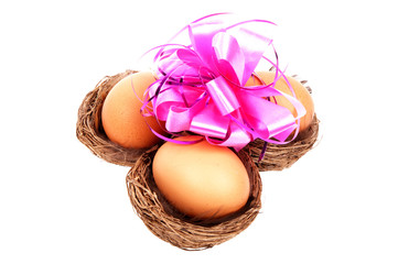 Three birds nests with an Easter egg
