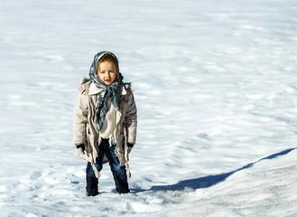Cute little girl portrait in snow field