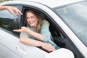 Young woman getting her new car key