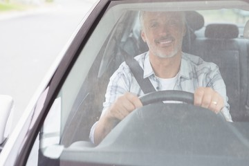 Man smiling while driving