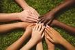 Leinwanddruck Bild - Children keeping hands together over grass