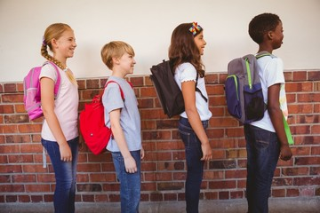School kids standing in school corridor