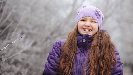 child laughing in winter