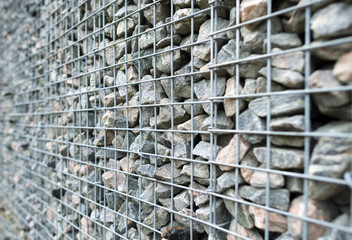 Wall of steel and stones in winter