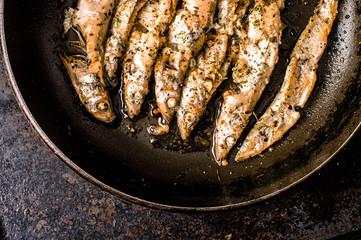Sprat, capelin fried in a pan