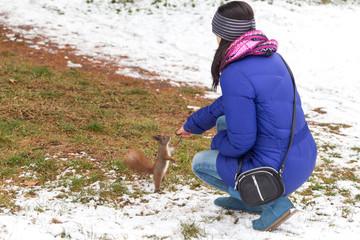 Girl feeding a squirell