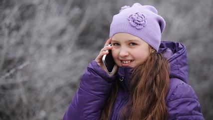child talking on the phone CU