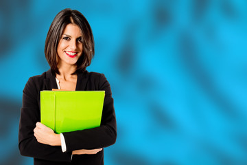 smiling professional woman on turquoise background