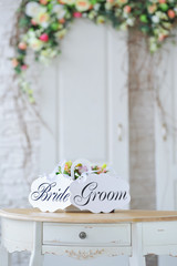 Elegant wedding decoration with flowers and bride groom boards