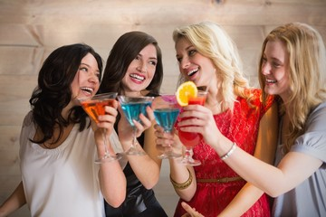 Composite image of friends with drinks