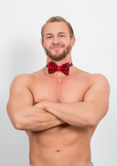 topless man wearing a red neckbow and smiling