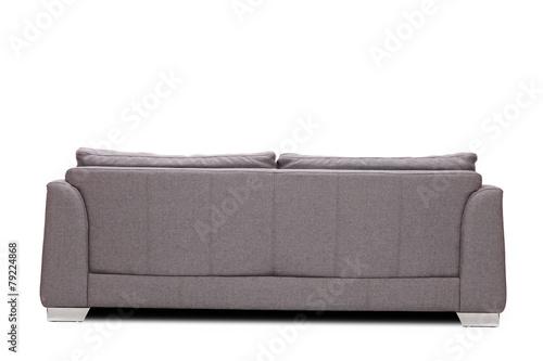 Leinwanddruck Bild Rear view studio shot of a modern gray sofa