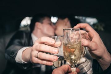 Bride and groom kissing cheers