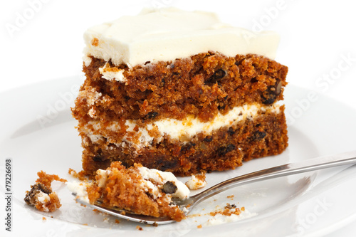 Papiers peints Biscuit Slice of carrot cake with rich frosting. On plate.