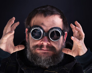 Crazy man with broken goggles