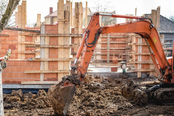 track-type loader working and leveling at construction site
