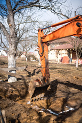 track-type loader excavator digging and leveling earth