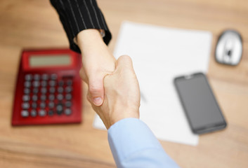Top view of businesswoman shaking  hand  with businessman  after