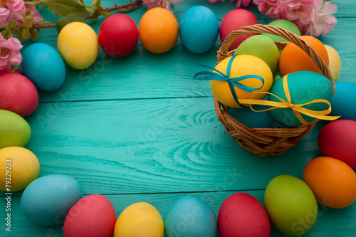 Ester eggs on blue wooden background - 79229233