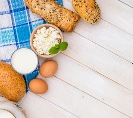 Breakfast of cheese, milk, bread and eggs