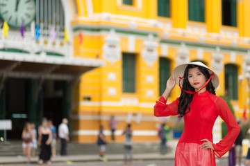 Stylish young Vietnamese woman in red
