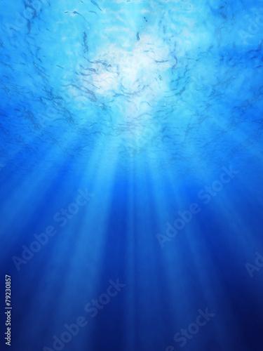 Blue ocean underwater light rays.