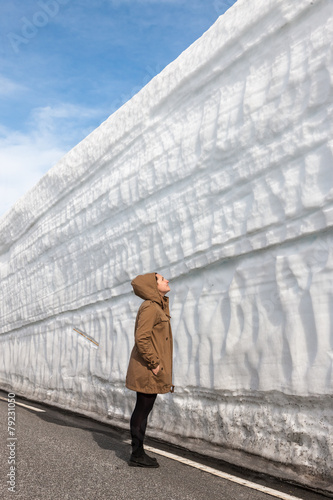 highway along the snow wall. Norway in spring - 79231050