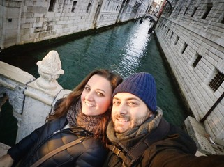 Young couple while taking a Selfie in Venice, Italy.