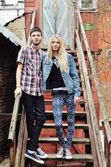 Full length portrait of two hipsters outdoor