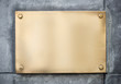 blank gold or brass metal sign or nameboard on concrete wall - 79234637