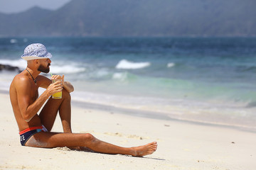 tanned, bearded man in sunglasses vacation concept