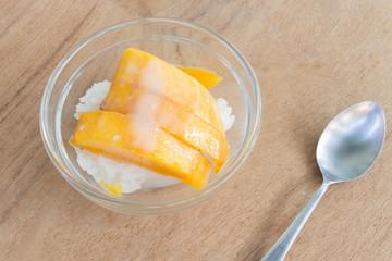mango with rice stick thai dessert on wood background