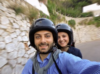Young couple while taking a Selfie in scooter