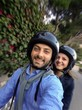 Young couple while taking a Selfie on the scooter.