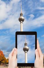 tourist taking photo of TV tower on alexanderplatz