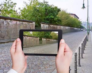 tourist taking photo of Berlin Wall