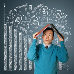 businessman hides under the laptop