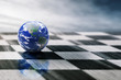 world on chessboard isolated blue sky background - 79237848