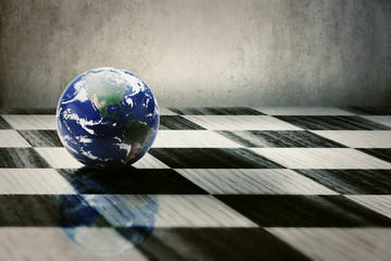 world earth on a chessboard isolated on grey wall background