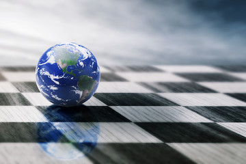 world on chessboard isolated blue sky background