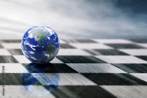 Leinwandbild Motiv world on chessboard isolated blue sky background