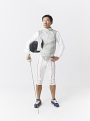 portrait of a male asian fencer
