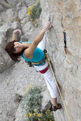 Happy smiling female climber